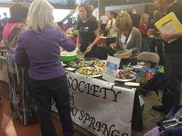 Handing out vegan food samples at HerbFest