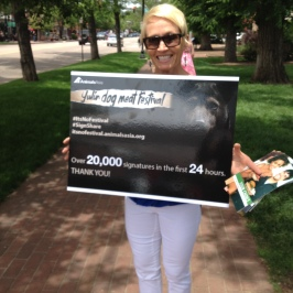 Sue creating awareness about the dog meat festival