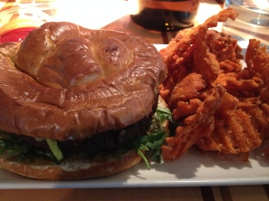 Veggie Burger on a Pretzel Bun with sweet potato fries at DIA's Root Down